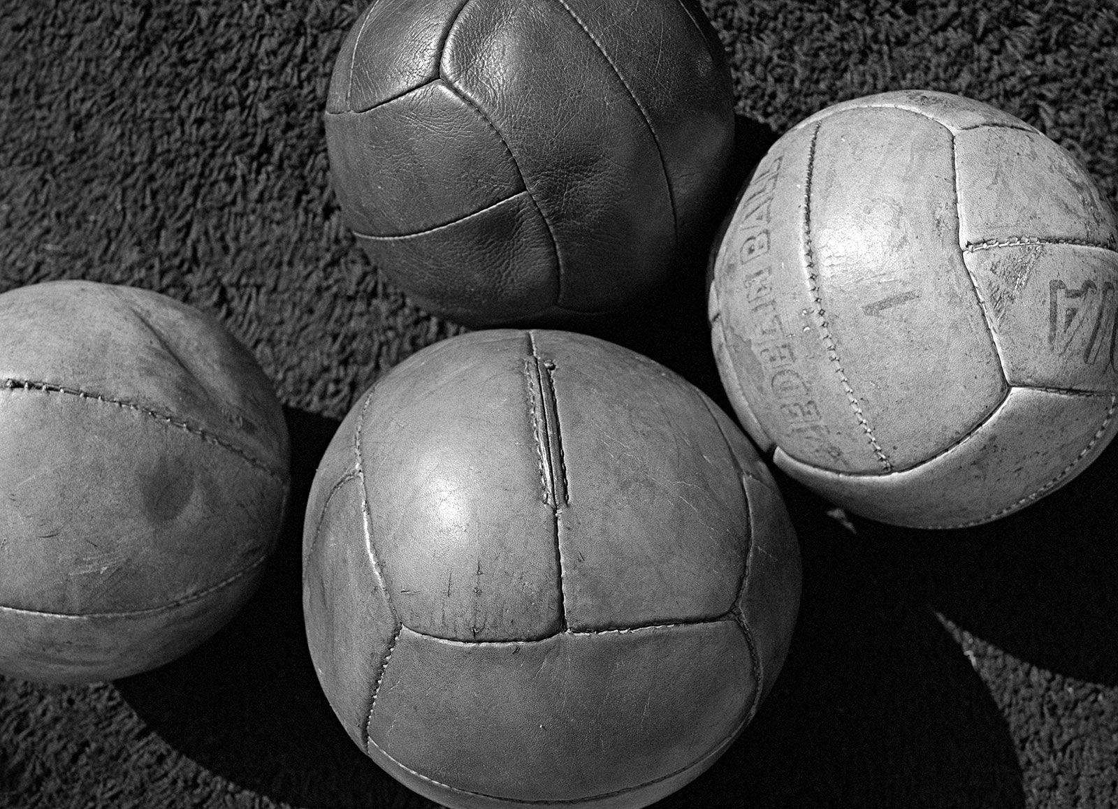 Four leather balls